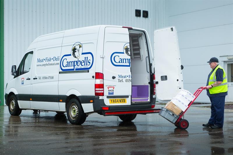 Image of man loading Campbells Prime Meats delivery fleet.