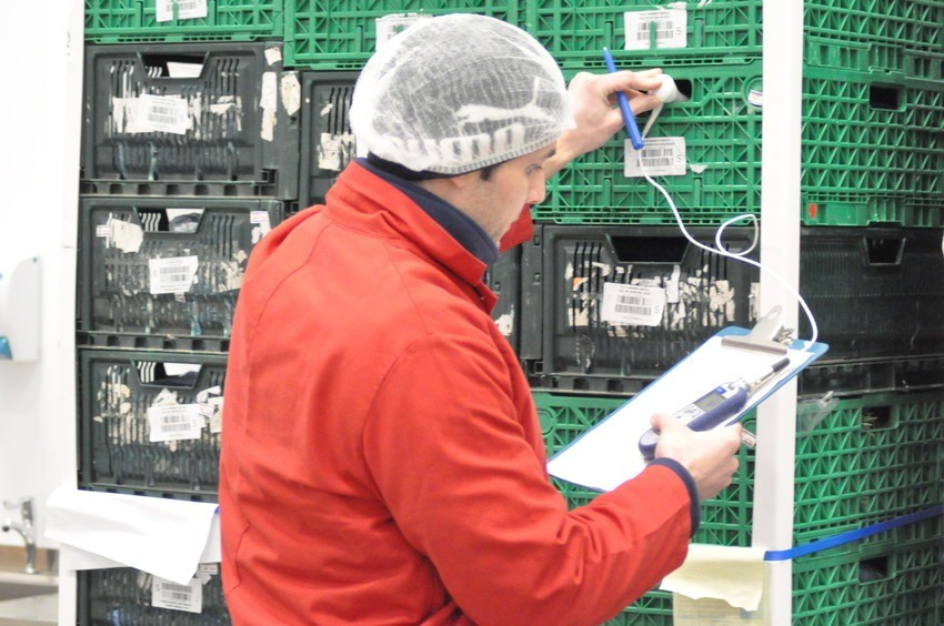 Image of person working on factory floor taking temperature of herbs to be audit ready.
