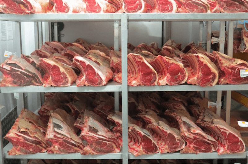 Image of ribs of beef on shelves at catering butcher