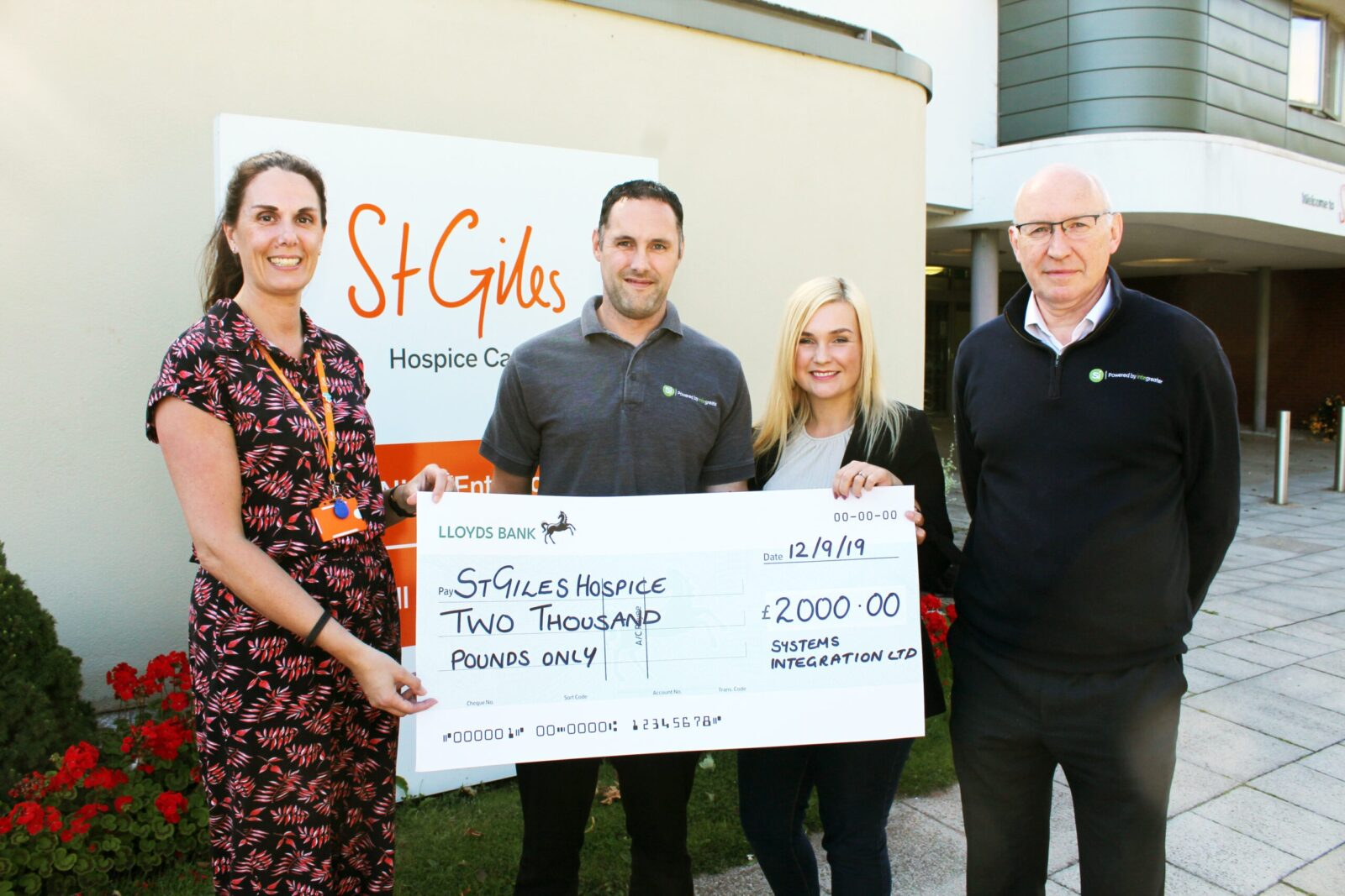 photo of cheque being given to st giles